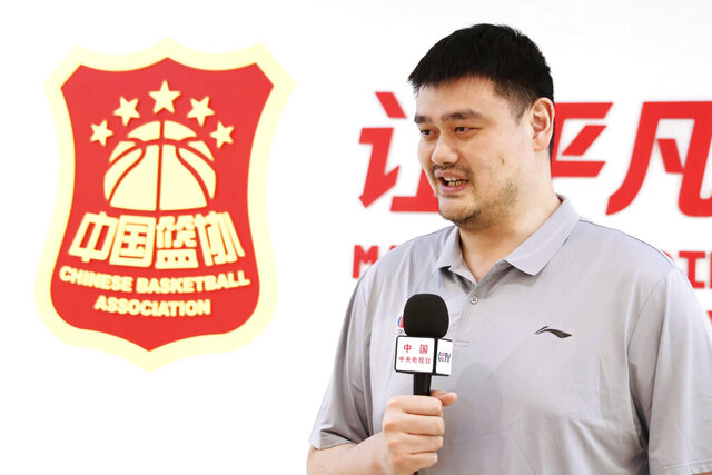 In this photo released by China's Xinhua News Agency, Chinese Basketball Association (CBA) President Yao Ming receives an interview in Beijing on June 4, 2020. The Chinese basketball league has restarted after an almost five-month shutdown for the coronavirus pandemic, with fewer foreign players and no fans in the stands. The CBA was suspended on Jan. 24, 2020 after the coronavirus outbreak in Wuhan, a week before it was scheduled to return following a spring break at the end of the regular season. The semifinals stage started Saturday, June 20, 20202 with 20 teams divided into two divisions and limited venues to reduce travel. All stadiums are closed to fans. League chairman and former NBA star Yao praised the work of the clubs and health authorities for helping get the CBA season restarted. (Meng Yongmin/Xinhua via AP)