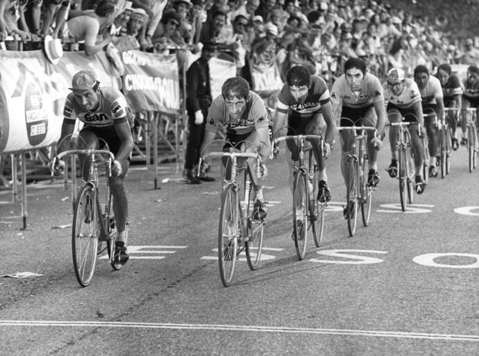 FILE - In this July 18, 1972 file photo, cyclists (from left to right) Raymond Poulidor, France, Cyrille Guimard, France, Felice Gimondi, Italy , Eddy Merckx, Belgium and Julio Jimenez, Spain, lead the pack during the 14. stage of the Tour de France cycling race from Valloire-Le Galibier to Aix les Bains. Tour de France organizers have confirmed that former rider Raymond Poulidor, known as