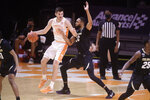 Tennessee's John Fulkerson (10) looks to get around Colorado's Dallas Walton (13) during an NCAA college basketball game Tuesday, Dec. 8, 2020, in Knoxville, Tenn. (Caitie McMekin/Knoxville New-Sentinel via AP, Pool)