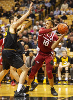 Arkansas's Daniel Gafford, right, looks to pass in front of Missouri's Reed Nikko, left, during the first half of an NCAA college basketball game Tuesday, Feb. 12, 2019, in Columbia, Mo. (AP Photo/L.G. Patterson)