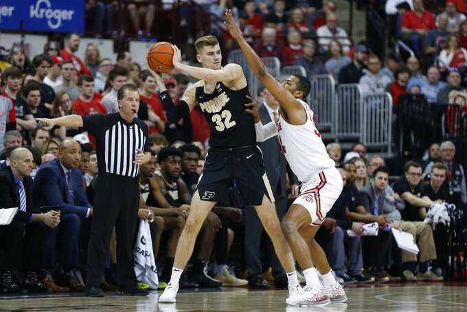 Purdue's Matt Haarms, left, looks for an open pass as Ohio State's Kaleb Wesson defends during the second half of an NCAA college basketball game Saturday, Feb. 15, 2020, in Columbus, Ohio. Ohio State beat Purdue 68-52. (AP Photo/Jay LaPrete)