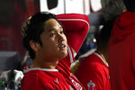 Los Angeles Angels' Shohei Ohtani sits in the dugout after being called out on strikes during the fourth inning of the team's baseball game against the Chicago White Sox on Tuesday, Sept. 14, 2021, in Chicago. (AP Photo/Charles Rex Arbogast)