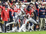 Mississippi wide receiver DaMarkus Lodge (5) is tackled by Mississippi State cornerback Cameron Dantzler (3) during an NCAA college football game in Oxford, Miss., Thursday, Nov. 22, 2018. (Bruce Newman/The Oxford Eagle via AP)