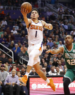 Phoenix Suns guard Devin Booker (1) shoots against the Boston Celtics during the second half of an NBA basketball game Thursday, Nov. 8, 2018, in Phoenix. The Celtics won 116-109 in overtime. (AP Photo/Matt York)