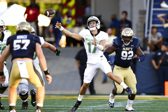 Marshall quarterback Luke Zban (17) passes the ball during the second half of an NCAA college football game against Navy, Saturday, Sept. 4, 2021, in Annapolis, Md. (AP Photo/Terrance Williams)