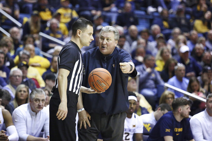 West Virginia coach Bob Huggins speaks with an official during the second half of an NCAA college basketball game against Oklahoma Saturday, Feb. 29, 2020, in Morgantown, W.Va. (AP Photo/Kathleen Batten)