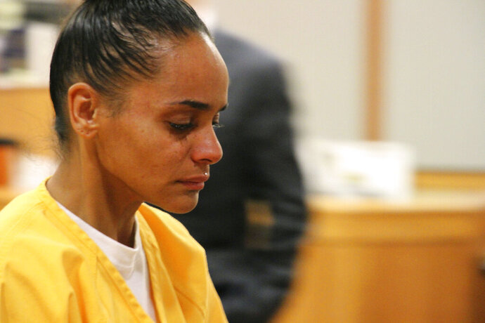 Gina Virgilio leaves the courtroom Monday, Oct. 14, 2019, in Anchorage, Alaska. Virgilio will service 60 years in prison for killing her boyfriend, Michael Gonzalez, in 2012 by setting the couch fire to the couch he was sleeping on. (AP Photo/Mark Thiessen)