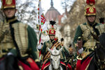 Hussars attend a ceremony during the 171th anniversary celebrations of the outbreak of the 1848 revolution and war of independence against the Habsburg rule in Budapest, Hungary, Friday, March 15, 2019. (Balazs Mohai/MTI via AP)