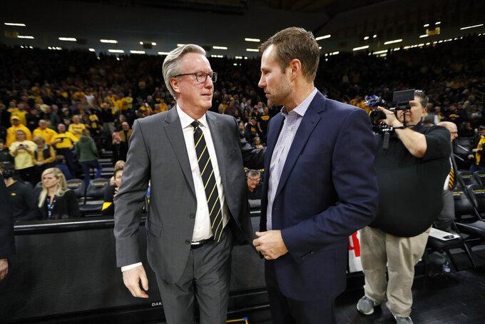 Iowa head coach Fran McCaffery, left, greets Nebraska head coach Fred Hoiberg before an NCAA college basketball game, Saturday, Feb. 8, 2020, in Iowa City, Iowa. (AP Photo/Charlie Neibergall)