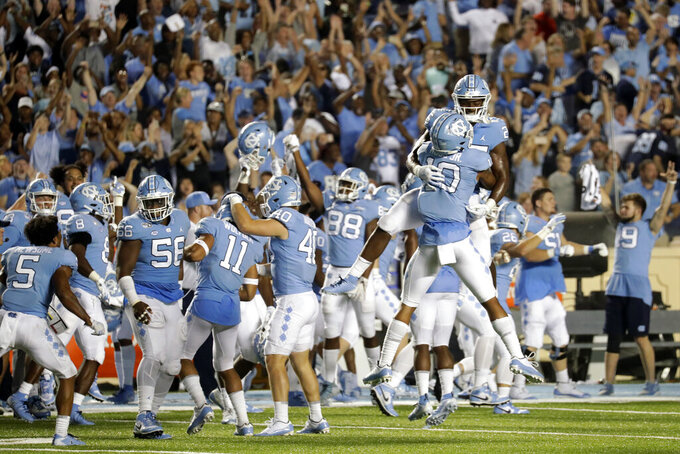 North Carolina celebrates a win over Miami in an NCAA college football game in Chapel Hill, N.C., Saturday, Sept. 7, 2019. (AP Photo/Chris Seward)