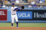 Los Angeles Dodgers second baseman Mookie Betts throws to first base to complete a double play on a ground ball from Colorado Rockies' Elias Diaz during the second inning of a baseball game Saturday, Aug. 28, 2021, in Los Angeles. (AP Photo/Marcio Jose Sanchez)