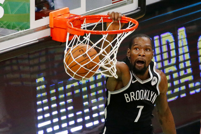 Brooklyn Nets forward Kevin Durant (7) dunks during the second half of an NBA preseason basketball game against the Boston Celtics, Friday, Dec. 18, 2020, in Boston. (AP Photo/Mary Schwalm)