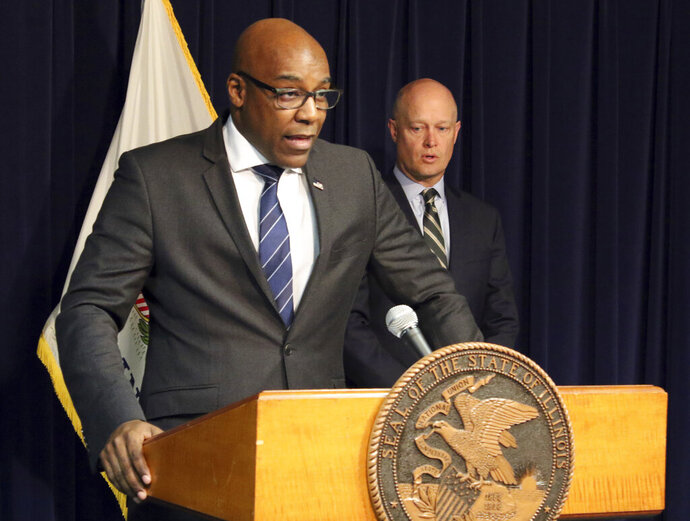 Attorney General Kwame Raoul, left, and Kane County State's Attorney Joseph McMahon speak during a news conference Monday, Feb. 11, 2019, in Chicago. Raoul and McMahon, who won the conviction against Jason Van Dyke, said they believe Judge Vincent Gaughan did not properly apply the law when he sentenced Van Dyke to six years and nine months in prison. In a rare move, they filed a request with the Illinois Supreme Court seeking an order that would send the case back to Gaughan for a new sentence. (AP Photo/Noreen Nasir)