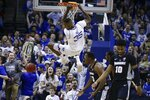 Providence's Kalif Young (13) and A.J. Reeves (10) react as Seton Hall's Romaro Gill (35) dunks the ball during the first half of an NCAA college basketball game Wednesday, Jan. 22, 2020, in Newark, N.J. (AP Photo/Frank Franklin II)