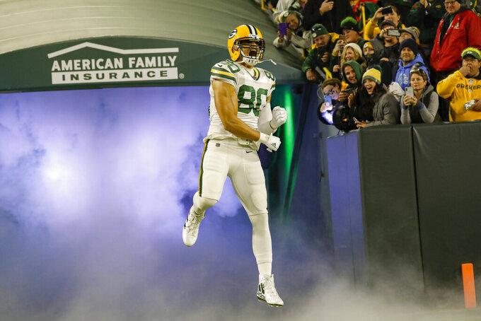 Green Bay Packers tight end Jimmy Graham runs out of the tunnel during the first half of an NFL football game against the Detroit Lions, Monday, Oct. 14, 2019, in Green Bay, Wis. (AP Photo/Jeffrey Phelps)
