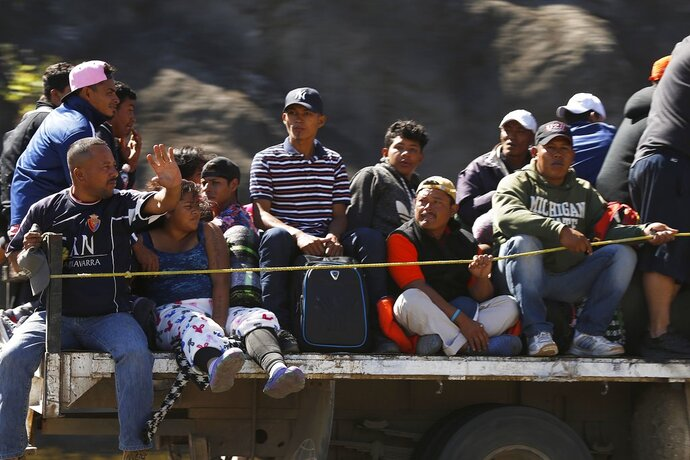 Central American migrants moving as a caravan toward the U.S. border get a free ride on a truck from Guadalajara, Mexico, Tuesday, Nov. 13, 2018. Many say they are fleeing rampant poverty, gang violence and political instability primarily in the Central American countries of Honduras, Guatemala, El Salvador and Nicaragua. (AP Photo/Marco Ugarte)