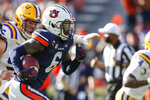 Auburn defensive back Christian Tutt (6) returns a fumble by LSU quarterback TJ Finley for a touchdown during the second quarter of an NCAA college football game Saturday, Oct. 31, 2020, in Auburn, Ala. (AP Photo/Butch Dill)