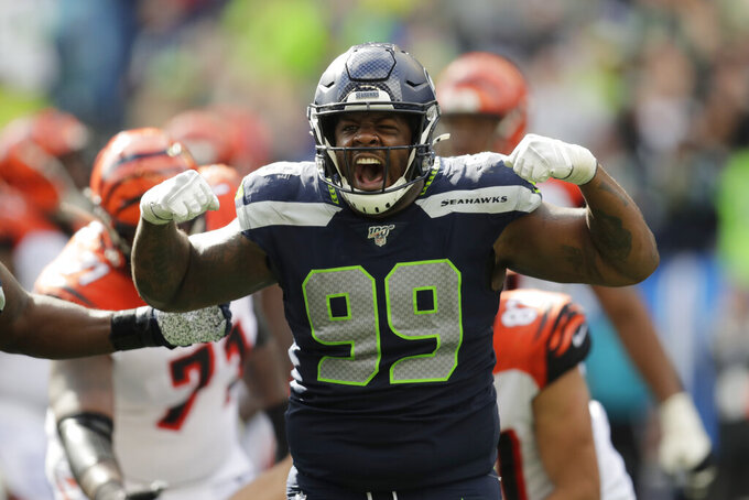 Seattle Seahawks defensive tackle Quinton Jefferson (99) reacts after he sacked Cincinnati Bengals quarterback Andy Dalton during the second half of an NFL football game Sunday, Sept. 8, 2019, in Seattle. (AP Photo/Stephen Brashear)