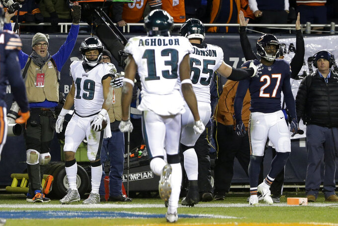 Philadelphia Eagles wide receiver Golden Tate (19) celebrates a touchdown during the second half of an NFL wild-card playoff football game against the Chicago Bears Sunday, Jan. 6, 2019, in Chicago. (AP Photo/David Banks)