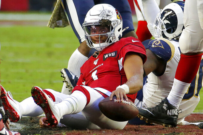 Arizona Cardinals quarterback Kyler Murray sits on the turf after being sacked against the Los Angeles Rams during the second half of an NFL football game, Sunday, Dec. 1, 2019, in Glendale, Ariz. (AP Photo/Rick Scuteri)