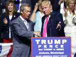 "FILE - In this Wednesday, Aug. 24, 2016 file photo, Republican presidential candidate Donald Trump, right, welcomes pro-Brexit British politician Nigel Farage, to speak at a campaign rally in Jackson, Miss. USA. Farage, the self-declared ""pantomime villain"" of Brexit, told the Associated Press Tuesday Jan. 14, 2020, he is leaving the European Union's parliament in Strasbourg later this week with a sense of mission accomplished. (AP Photo/Gerald Herbert, File)"
