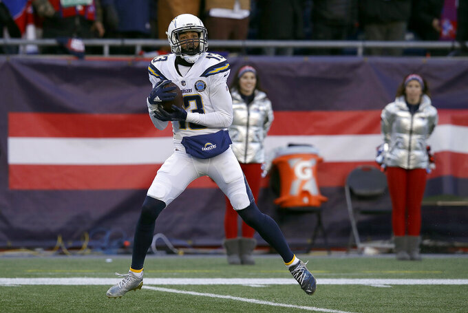 Los Angeles Chargers wide receiver Keenan Allen catches a pass that he ran in for a touchdown against the New England Patriots during the first half of an NFL divisional playoff football game, Sunday, Jan. 13, 2019, in Foxborough, Mass. (AP Photo/Charles Krupa)