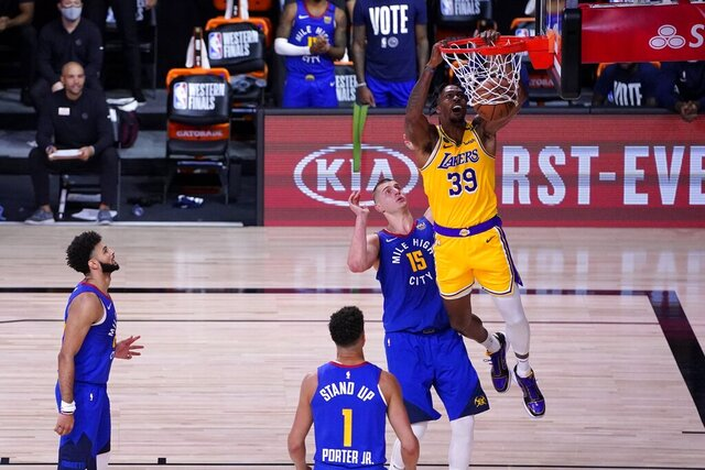 Denver Nuggets' Jamal Murray, left, Michael Porter Jr. (1) and Nikola Jokic (15) defend as Los Angeles Lakers' Dwight Howard (39) dunks the ball during the second half an NBA conference final playoff basketball game, Friday, Sept. 18, 2020, in Lake Buena Vista, Fla. (AP Photo/Mark J. Terrill)