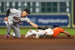 Houston Astros' Jose Siri, right, is tagged out by Arizona Diamondbacks shortstop Nick Ahmed while trying to steal second base during the eighth inning of a baseball game Friday, Sept. 17, 2021, in Houston. (AP Photo/David J. Phillip)