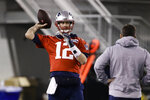New England Patriots quarterback Tom Brady throws a pass during NFL football practice, Friday, Feb. 1, 2019, in Atlanta, as the team prepares for Super Bowl 53 against the Los Angeles Rams. (AP Photo/Matt Rourke)