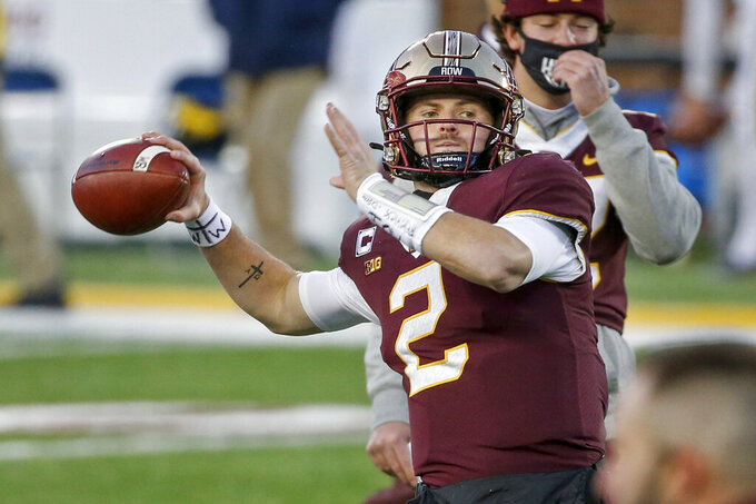 Minnesota quarterback Tanner Morgan throws in preparation for an NCAA college football game against Michigan, Saturday, Oct. 24, 2020, in Minneapolis. (AP Photo/Bruce Kluckhohn)