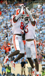 Clemson's Tee Higgins (5) celebrates his touchdown with Justyn Ross (8) during the fourth quarter of an NCAA college football game against North Carolina in Chapel Hill, N.C., Saturday, Sept. 28, 2019. (AP Photo/Chris Seward)