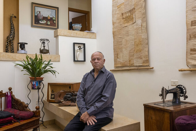 Dr Shmuel Rosenman, chairman of the March of the Living poses for a photo at his house in Moshav Hemed, Israel, Wednesday, April 7, 2021. The March of the Living is saluting medical heroes this year. The annual Holocaust education event is usually marked with a march on the grounds of the former Auschwitz death camp in Poland. But for a second straight year it is being held virtually due to the coronavirus pandemic. (AP Photo/Tsafrir Abayov)