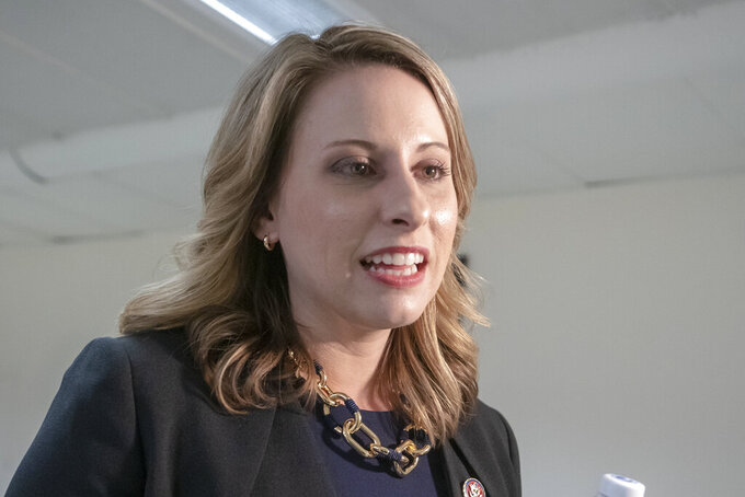 FILE - In this April 3, 2019, file photo, then- Rep. Katie Hill, D-Calif., is seen on Capitol Hill in Washington. The former California congresswoman has been ordered to pay about $220,000 in attorneys' fees to a British tabloid and two conservative journalists she sued after the publication of intimate photos without her consent. (AP Photo/J. Scott Applewhite, File)