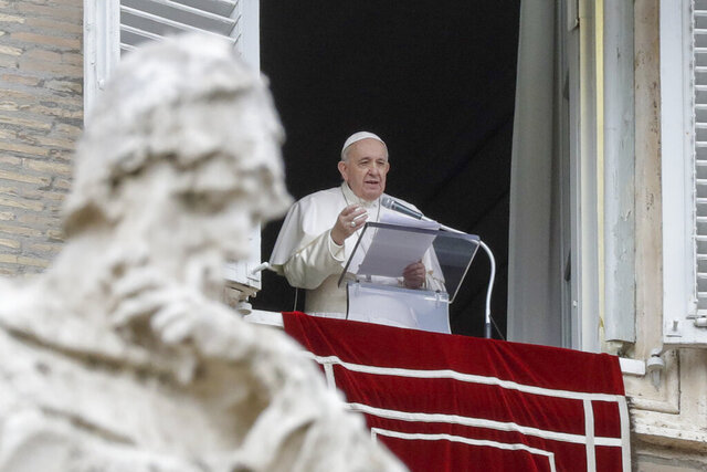 """FILE - In this Dec. 8, 2020 file photo, Pope Francis delivers his message during the Angelus noon prayer from the window of his studio overlooking St.Peter's Square, on the Immaculate Conception day, at the Vatican. Pope Francis is once again canceling public appearances due to nerve pain. Francis will not participate in three events over the coming days """"due to a recurrence of sciatica,"""" Vatican spokesman Matteo Bruni said in a statement on Saturday, Jan. 23, 2021. (AP Photo/Andrew Medichini, file)"""