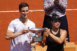 USA's Desirae Krawczyk, right, and Britain's Joe Salisbury hold the cup after defeating Russia's Elena Vesnina and Aslan Karatsev in their mixed doubles final match of the French Open tennis tournament at the Roland Garros stadium Thursday, June 10, 2021 in Paris. (AP Photo/Christophe Ena)