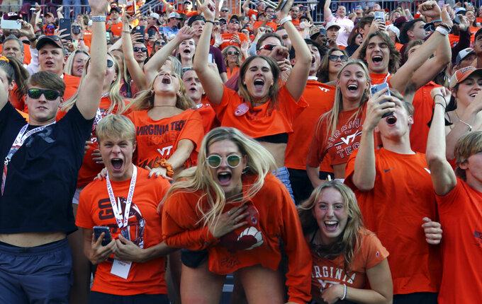 Virginia Tech fans await the start of the team's NCAA college football game against North Carolina on Friday, Sept. 3, 2021, in Blacksburg, Va. (Matt Gentry/The Roanoke Times via AP)