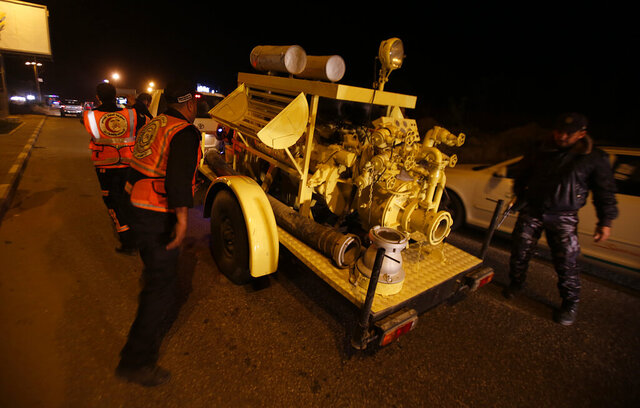Rescue vehicles, part of a convoy of around 20, arrives in Gaza City, Tuesday, Dec. 17, 2019. Palestinian officials say Israel has allowed the import of around 20 rescue and firefighting vehicles. The equipment was donated by Qatar. (AP Photo/Hatem Moussa)