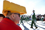 Wisconsin resident Ken Palubicki wears a cheesehead hat as he watches the 131st Rose Parade in Pasadena, Calif., Wednesday, Jan. 1, 2020. (AP Photo/Michael Owen Baker)
