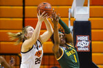 Oklahoma State forward Abbie Winchester (25) and Baylor forward NaLyssa Smith (1) reach for a rebound during the first half of an NCAA college basketball game Wednesday, Jan. 20, 2021, in Stillwater, Okla. (AP Photo/Sue Ogrocki)