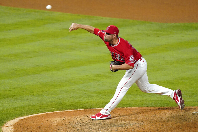 Los Angeles Angels relief pitcher Hunter Strickland throws to the plate during the ninth inning of a baseball game against the Texas Rangers Tuesday, May 25, 2021, in Anaheim, Calif. (AP Photo/Mark J. Terrill)