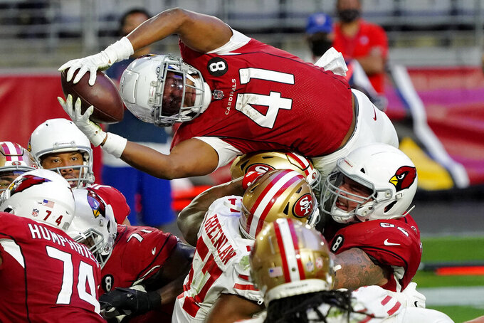 FILE - Arizona Cardinals running back Kenyan Drake (41) dives over the line for a touchdown against the San Francisco 49ers during the second half of an NFL football game in Glendale, Ariz., in this Saturday, Dec. 26, 2020, file photo. The Las Vegas Raiders have agreed to a two-year deal worth up to $14.5 million with free agent running back Kenyan Drake to complement starter Josh Jacobs.  A person familiar with the deal says Drake will be guaranteed $11 million under the deal agreed to on Thursday, March 18, 2021. The person spoke on condition of anonymity because the deal hasn't been announced. (AP Photo/Rick Scuteri, File)