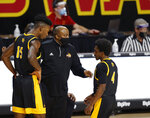 Arkansas-Pine Bluff head coach George Ivory, center, talks with forward Alvin Stredic, left, and guard Joshuwa Johnson, right, during a timeout in the first half half of an NCAA college basketball game against Iowa State, Sunday, Nov. 29, 2020, in Ames, Iowa. (AP Photo/Matthew Putney)