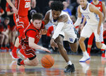 Utah's Rylan Jones, left, and Kentucky's Ashton Hagans scramble for the ball during the second half of an NCAA college basketball game Wednesday, Dec. 18, 2019, in Las Vegas. (AP Photo/John Locher)