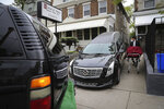 Preston Griffin, who runs First Class Mortuary Transport, delivers a body to the Deborah L. Wilson Funeral Home in Philadelphia, Pa. on May 6, 2020. (David Maialetti/The Philadelphia Inquirer via AP)