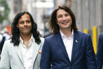 Vladimir Tenev, CEO and Co-Founder of Robinhood, right, walks in New York's Times Square with fellow Co-Founder Baiju Bhatt following their company's IPO, Thursday, July 29, 2021. Robinhood is selling its own stock on Wall Street, the very place the online brokerage has rattled with its stated goal of democratizing finance. Through its app, Robinhood has introduced millions to investing and reshaped the brokerage industry, all while racking up a long list of controversies in less than eight years. (AP Photo/Mark Lennihan)
