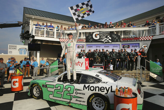 Austin Cindric celebrates after winning the NASCAR Xfinity Series auto race at Watkins Glen International, Saturday, Aug. 3, 2019, in Watkins Glen, N.Y. (AP Photo/John Munson)