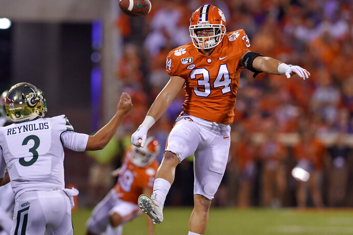 Clemson's Logan Rudolph (34) blocks the pass attempt by Charlotte's Chris Reynolds during the first half of an NCAA college football game Saturday, Sept. 21, 2019, in Clemson, S.C. (AP Photo/Richard Shiro)
