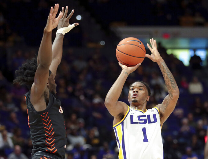 LSU guard Javonte Smart (1) shoots in front of Bowling Green guard Caleb Fields during the first half of an NCAA college basketball game in Baton Rouge, La., Friday, Nov. 8, 2019. (AP Photo/Brett Duke)