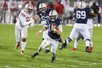 Penn State quarterback Sean Clifford (14) carries against Ohio State during the second quarter of an NCAA college football game in State College, Pa., Saturday, Oct. 31, 2020. (AP Photo/Barry Reeger)