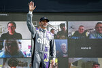 Jimmie Johnson waves to the crowd during driver introductions prior to a NASCAR Cup Series auto race at Phoenix Raceway, Sunday, Nov. 8, 2020, in Avondale, Ariz. (AP Photo/Ralph Freso)